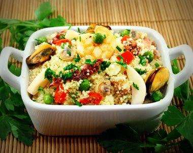 Couscous ai frutti di mare con piselli e pachino