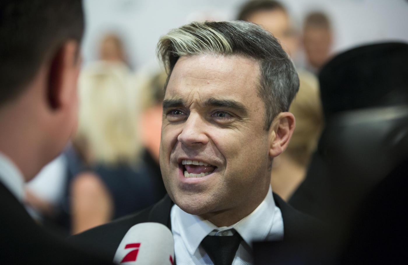 Robbie Williams compie 40 anni03