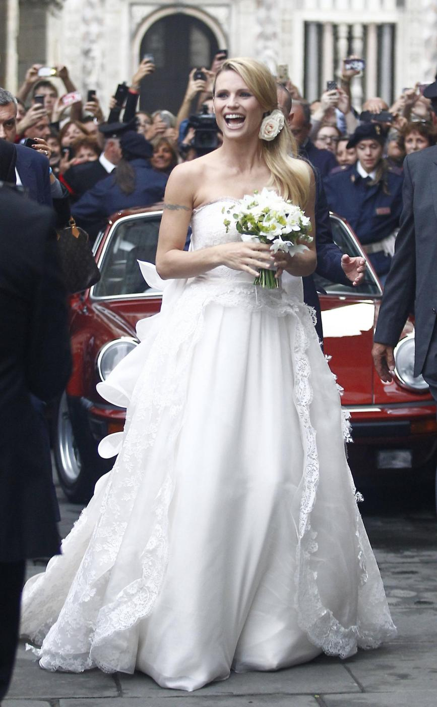 Michelle Hunziker e Tomaso Trussardi sposi. Le prime foto delle nozze