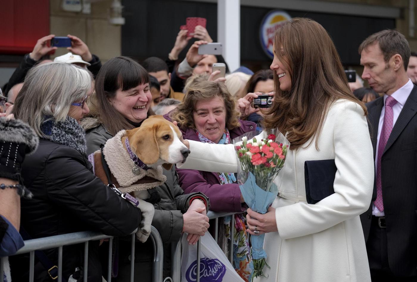 Kate Middleton torna dai Caraibi abbronzata e con un bel pancione 14