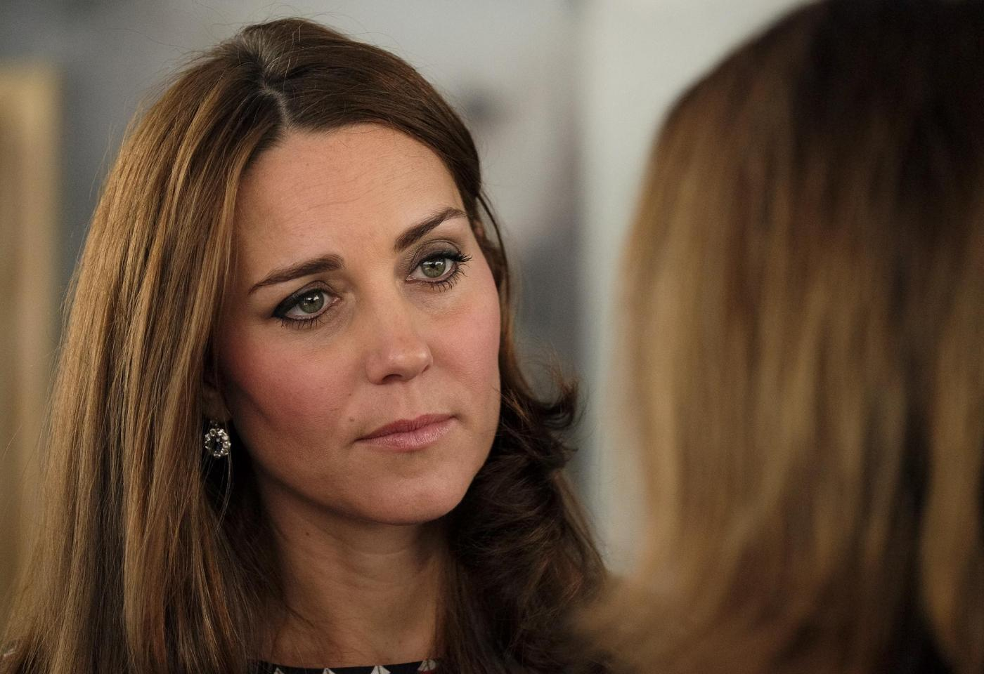 Kate Middleton torna dai Caraibi abbronzata e con un bel pancione 12