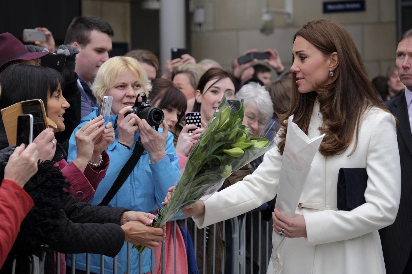 Kate Middleton torna dai Caraibi abbronzata e con un bel pancione 09
