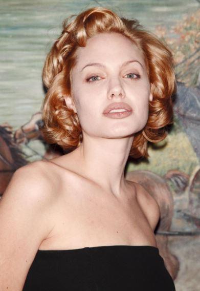 Angelina Jolie, com'era e com'è. L'attrice compie 40 anni FOTO 60