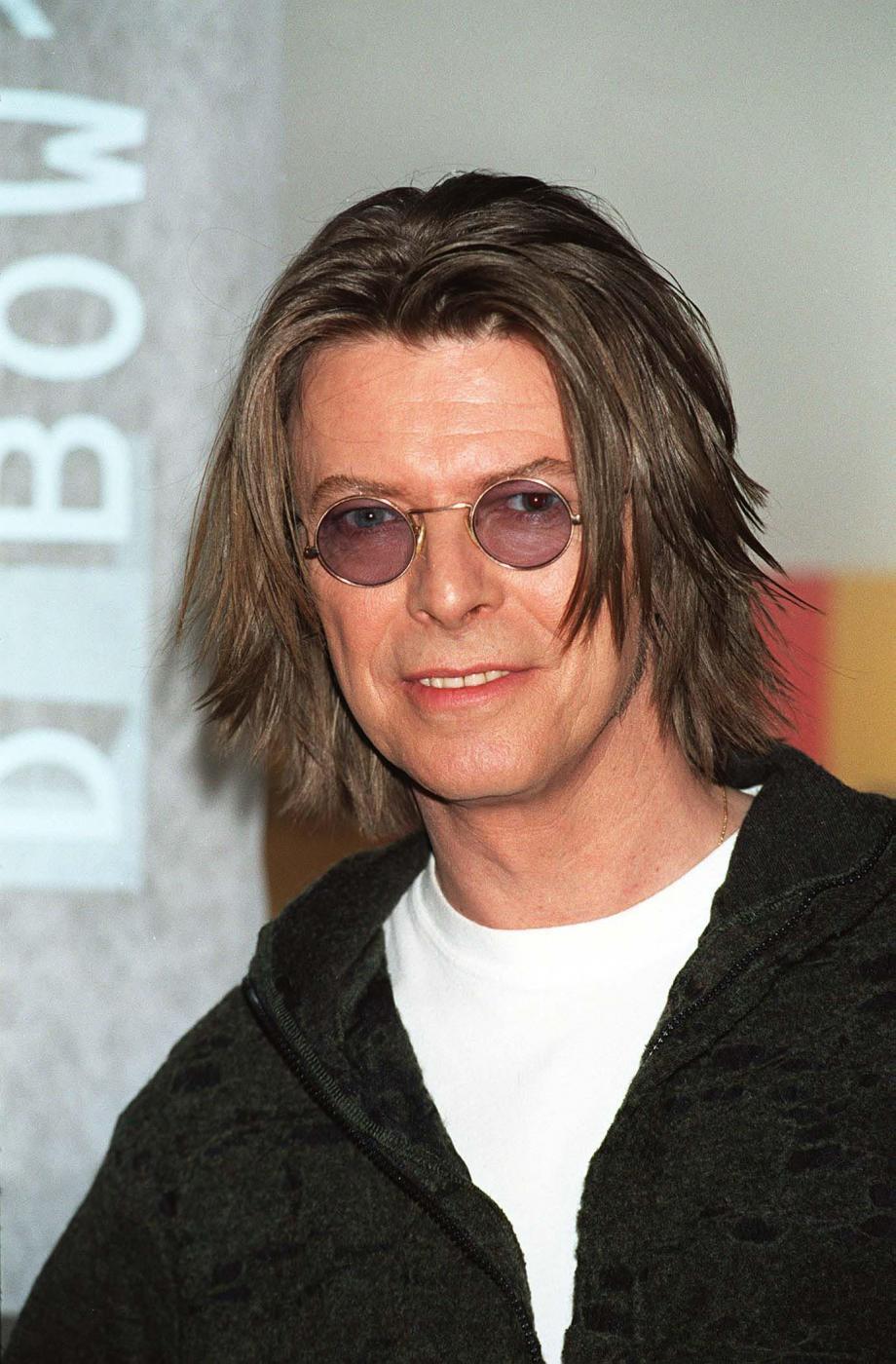 """David Bowie versione romantica. Moglie Iman: """"Mi fece trovare stanza piena di fiori"""" 11"""