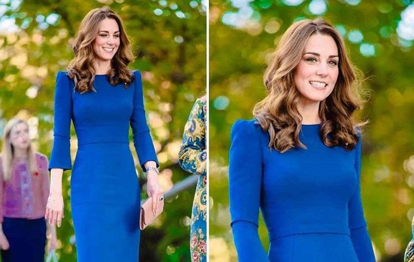 Abito blu riciclato per Kate Middleton che si presenta a sorpresa ad un evento